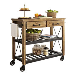 """Crosley - Roots Rack Industrial Kitchen Cart - The relaxed lifestyle of French Wine country comes to life in Crosley's new Roots Rack. Its rustic design is reflective of a time when recycling wasn't a societal choice, but a way of life. Starting with a solid pine top, we simulate the popular """"reclaimed"""" wood look by hand - etching a weathered plank design into the surface. The rich honey finish extends to the sturdy legs, riding on industrial style casters wrapped in rubber. Two spacious drawers sit on full-extension glides, providing maximum utility. The sturdy metal shelves are finished in black, and are perfectly notched to secure individual wine bottles. Completing the package are industrial style drawer pulls, towel bars, and X- supports. The Roots Rack is perfect for any kitchen activity - slicing, dicing, mixing, or mingling."""