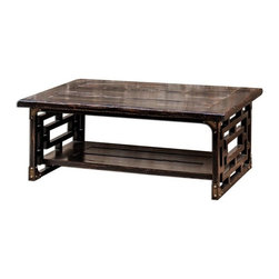 Uttermost - Matthew Williams Deron Wooden Coffee Table - Plantation-grown mango wood, planked and carved in rubbed black finish with red wood undertones and antique brass metal corner plates.
