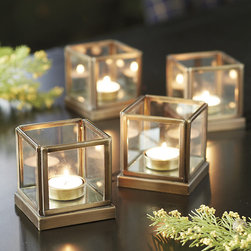 Ballard Designs - Set of 4 Le Marais Tea Light Holders - Coordinates with our 9-Light Le Marais Candle Holder. Steel frame with clear glass sides. Antique brass finish. Tea light not included. This single tea light candle holder is just the right size to illuminate a table for four, a powder room or porch step. Use multiples to define a patio or a walk when entertaining. Inside base is covered in antiqued mirror to create extra sparkle as it amplifies the light.Le Marais Candle Holder features: . . . .