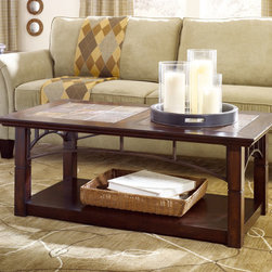 "Hammary - Hammary Vecchio 2 Piece Rectangular Cocktail Table Set - Even as Hammary's stirring new ""Vecchio"" collection fills your home with modern-day beauty, its unique design will transport you back to serene, simpler times. A childhood home, a grandmother's kitchen - the dearest places frozen in our memories come to life in this design. This lovely four-piece group draws inspiration from items that have always charmed us, captured our imagination, and harkened back to days when homemade meant more than mass-produced. Crafted from birch veneers and iron accents, these pieces are inspired by the natural aspects of the wood along with the earthy tones of slate and strength of the iron - giving each piece a warm, welcoming feel. The Mid-Tone finish, coupled with natural slate and burnished patina glazed iron, will brighten any setting. Included are a rectangular mobile cocktail table, rectangular end table, console and media console. Such variety ensures increased functionality, as well as flow and continuity from room to room. And while every piece is different, the common design elements, such as elegant trestles, bind the group together in a beautiful way. ""Vecchio"" from Hammary. It's more than just furniture. It's a time machine where the styles of past and present meet to embolden and enliven your home for years to come. - T30015-T3001500-00-2-SET.  Product features: One Fixed Shelf; W42"" x D20"" x H8.5"". Product includes: Cocktail Table (1); End Table (1). 2 Piece Cocktail Table Set belongs to Vecchio Collection by Hammary."