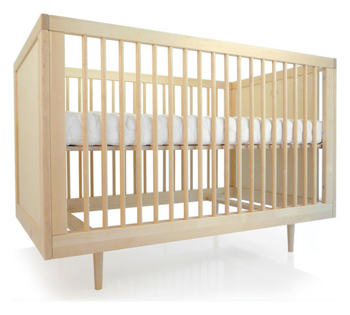"Spot on Square - Spot on Square Ulm Crib - Spot on Square presents eco-conscious nursery furniture with an innovative, contemporary aesthetic. The Ulm crib transforms a little one's room into a sophisticated, mid-century modern bedroom. This birch wood furnishing offers clean lines, tapered legs and three adjustable mattress positions for comfort and safety. As baby grows, the crib converts to a toddler daybed with an optional conversion kit. Made in Europe from solid birch and birch plywood with a non-toxic finish. Mattress not included. Some assembly required. 29.5""W x 53.5""D x 36""H."