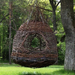 Treelax - Treelax is a human nest from Dreamweaver Nests in Northern Wisconsin.  Featured in the Huffington Post as the coolest backyard feature ever,  This six foot hanging nest is the ultimate natural escape.