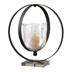 Uttermost Charon Metal Candleholder - Dark rust bronze metal rings with a crystal base and transparent amber glass globe with off-white candle. Dark, rust bronze metal rings suspend the transparent amber glass globe; all seated on a crystal base. Off-white candle included.