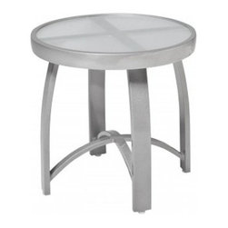 Woodard Wyatt Flex 18 in. End Table - Keep snacks and drinks handy for your guests with a little help from the Woodard Wyatt Flex 18 in. End Table. Boasting clean lines and a contemporary design, this accent piece is perfect for pairing with Wyatt Flex lounge chairs to create a cozy place to catch up with friends. Sturdily constructed of fully welded aluminum, this table sports a smoked glass table top. Available in a choice of powder-coated finishes, it will easily coordinate with your existing patio furniture and will not rust, peel, or blister even after years of use. What's more, it is virtually maintenance-free and easily hoses off to clean. Made by Woodard, the leader in quality patio furniture for 140 years, this chat table offers a perfect blend of upscale elegance and lasting function.Important NoticeThis item is custom-made to order, which means production begins immediately upon receipt of each order. Because of this, cancellations must be made via telephone to 1-800-351-5699 within 24 hours of order placement. Emails are not currently acceptable forms of cancellation. Thank you for your consideration in this matter.For over 140 years, Woodard craftsmen have designed and manufactured products loyal to the timeless art of quality furniture construction. Using the age-old art of hand-forming and the latest in high-tech manufacturing, Woodard remains committed to creating products that will provide years of enjoyment.Superior Materials for Lasting DurabilityIn the Aluminum Collections, Woodard's trademark for excellence begins with a core of seamless, virgin aluminum: the heaviest, purest, and strongest available. The wall thickness of Woodard frames surpasses the industry's most rigid standards. Cast aluminum furniture is constructed using only the highest grade aluminum ingots, which are the purest and most resilient aluminum alloys available. These alloys strengthen the furniture and simultaneously render it malleable. The end result is a fusion of durabi