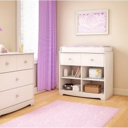 South Shore Little Jewel Changing Table - White - The South Shore Little Jewel Changing Table - White is a gem of a way to transform your baby nursery to a big girl room. This changing table is crafted of sturdy engineered wood in a pure white finish. It features clear plastic crystal knobs that she'll love. The changing table becomes a handy spot for books and more when baby gets older. One spacious drawer has metal side guides for smooth operation. Below are four open cubby spaces for baby essentials now and her favorite treasures down the road. About South Shore FurnitureA recognized leader in North American furniture manufacture South Shore Industries was established in 1940 and has been making furniture for three generations. Employing a team of over 1 000 employees in three factories in Quebec their assembled and ready-to-assemble furniture has a reputation for quality and excellence at affordable prices for today's family. A Green ChoiceAll South Shore Industries products are made of laminated engineered wood which gives them great strength and durability. Wood panels are made entirely from recovered and recycled material. While South Shore makes every effort to preserve the environment by conserving our forests they make no compromise when it comes to quality and product durability. Their products are designed for easy maintenance and offered at very competitive prices.