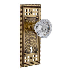Nostalgic Warehouse - Nostalgic Craftsman Plate with Crystal Knob and Keyhole in Antique Brass - Inspired by the American Arts & Crafts movement of the early 1900s, the rugged design and hand-hammered details of the Craftsman Long Plate in antique brass emphasizes handwork over mass production. Add our Crystal Knob, with its smooth center flawlessly flowing into fluted edges, for a striking match. All Nostalgic Warehouse knobs are mounted on a solid (not plated) forged brass base for durability and beauty.