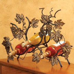 J & J Wire Vine Wine Rack - The J & J Wire Vine Wine Rack lets you picture yourself gorging on grapes plucked straight from the vineyard ... only these grapes have already been improved by the fermentation process. Antique gold grapes leaves and vines swirl about in this sculptural wine rack which holds bottles in easily accessible slots tucked within the foliage. Proudly made in the USA from wrought iron with a black powder-coat finish this freestanding unit has rubber tips on the legs to prevent scratching your table or counter.About J & J Wire Inc.Located at the Industrial Park in Beatrice Nebraska J & J Wire Inc. started 25 years ago as a wire-forming business manufacturing mostly houseware items. Since then the company has grown into a metal fabrication business serving customers in many different manufacturing sectors in the United States and Canada. From quilt racks to wine racks J & J Wire is committed to creating handmade works of art at affordable prices.