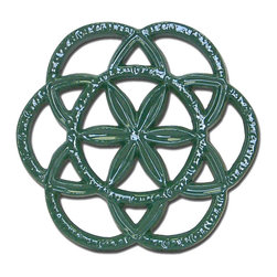 John Wright - Forest Green Circle & Star Trivet - Reminiscent of Pennsylvania Dutch design, this trivet has so many possibilities. You can use it under one of our steamers to protect your wood stove from scratches, in your kitchen under hot pans, under a potted plant, or as the base of a table centerpiece. Better yet, just hang it on the wall for decoration!