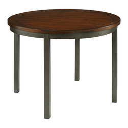 HomeStyles - Round Dining Table - Our Cabin Creek collection conveys a reclaimed wood vintage feel. Each piece is physically distressed by hand, providing a unique one of a kind look. The Cabin Creek Round Table is constructed of hardwood solids and veneers in a heavily distressed multi-step chestnut finish featuring worm holes, fly specking, small indentations, and season splitting. Additional features include a hammered metal look finished frame. 42 inch round table. Assembly required. 42 in. W x 42 in. D x 30 in. H