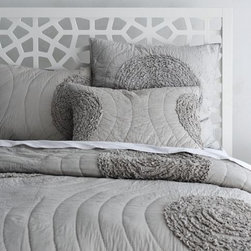 Ruffled-Circle Quilt - Monochromatic swirls and ruffles make this quilt feminine and romantic. Pair it with yellow accessories for a popular combination, or try raspberry pink and mirrored nightstands for a glamorous look.