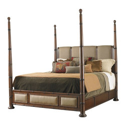 Tommy Bahama - Tommy Bahama Landara Monarch Bay California King Poster Bed - Padded panels of elegant woven linen in a rich chestnut brown coloration grace the headboard and footboard. Adjustable high and low post options topped with carved finials make this bed as beautiful as it is comfortable. Fabric available only as shown in Sawgrass.  An intriguing collection whose elegant style exquisite detail and eclectic blend of materials draw inspiration from the worlds most coveted retreats Landara celebrates the lifestyle of refined destination living. The collections inspiration is not bound by geography but defined by the influence of destination living on lifestyle and attitude � from Martinique to the Maldives.  Designs in Landara blend classic British Campaign and Colonial styling with indigenous influences from the West Indies the Pacific Rim and African Safari. Crafted from Burnished Maple and Quartered Rosewood pieces are accented with woven rattan panels graceful shaped rattan leather carved bamboo crushed bamboo raffia burnished brass ferrules and corner brackets and aged brass nailhead trim. Upholstered seating in the collection is plush and comfortable with distinctive styling and four richly layered color palettes that speak to the theme of destination travel. The Tommy Bahama Furniture brand is legendary for its sophisticated interpretation of inspired island living. We believe that experiencing the casual comfort of the islands should be as easy as walking through your own front door. The Tommy Bahama Home furniture collection of distinctive furnishings evokes a sense of romance and intrigue through the fusion of eclectic design exotic natural materials and rich finishes. We invite you make life one long weekend and capture the essence of resort living with the cool and casual style of Tommy Bahama. Tommy Bahama by Lexington Home Brands is a global manufacturer and marketer of distinctive home furnishings and an industry leader in innovative design and lifestyle marketing. Our award-winning product line of wood and upholstered furniture encompasses a wide range of designs and styles with recognized brands like Lexington Tommy Bahama Sligh Residential products are distributed through independent retailers interior designers design firms and to-the-trade showrooms. We also produce contract and custom contract furnishings for hospitality and commercial use. Tommy Bahama by Lexington Home Brands is headquartered in High Point NC with showroom facilities in High Point and Las Vegas. Founded in 1903 Lexington Home Brands is one of the most respected companies in the industry having built a reputation for design leadership and exceptional value. The company is privately-held by Sun Capital Partners Inc. based in Boca Raton FL. For more information connect with Sun Capital Partners on LinkedIn. Your lifestyle and aspirations for your home are uniquely personal. Tommy Bahama by Lexington Home Brands passion lies in assisting you in creating an environment that brings that vision to life with exceptional styling for every room and lifestyle. Whether your taste runs contemporary or traditional casual or formal Lexington Home Brands have designs that will inspire you.