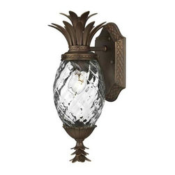 Hinkley - Plantation Outdoor Wall-Mounted Lantern - Give your home a traditional symbol of hospitality with this charming outdoor lantern. The rich copper bronze finish emphasizes the leaves and beautiful hand blown clear optic glass. This pineapple inspired piece will enhance the welcoming feeling of your home.  Hinkley - 2226CB