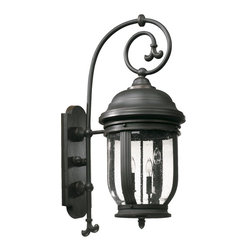 Quorum Lighting - Quorum Lighting Summit Transitional Outdoor Wall Sconce X-59-4-2817 - Beautiful and intricate details add to the appeal of this stylish Quorum Lighting outdoor wall sconce. From the Summit Collection, the traditional lantern design and exaggerated scrolling arm are accentuated by a stylish Old World finish. A clear seeded glass shade pulls the look together.