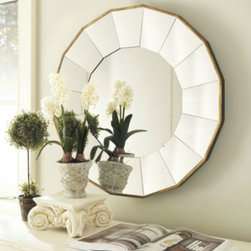 Concave Sunburst Mirror - Gold accents can make a huge visual impact; this mirror features an antique gold trim that is subtle yet powerful.