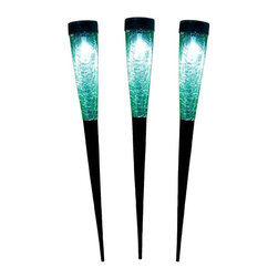 "Achla - Solar Cones Light Green 3pk - Each cone is 15 1/2 in. h with spiked bottoms. Crackle glass emits beautiful light. Lithium-Ion battery for a long lasting glow. 2 in. D X 2 in. W X 15.5 in. HA great way to add sparkle, light and a festive feel to any spot without running expensive, electrical wiring. Sometimes referred to as ""living lights"", these cones provide the warmth often associated with candlelight. The glass is crackle and mouth blown. Available in 6 colors. The solar panel is easy to charge and should last about 6  - 8 hours."