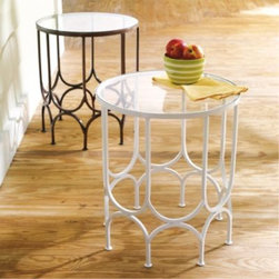 Bella Outdoor Iron Table - Grandin Road - I like the design of the iron frames in this cute little side table. It has a retro feel while remaining contemporary at the same time.