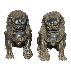 "Golden Lotus - Pair Chinese Dark Green Marble Fen Shui Foo Dogs - This is a beautiful pair of marble stone Foo Dog. The male Foo Dog has an embroidered ball under its paw and the female has a baby Foo Dog. Its carving is very detail, even their paws, bodies, and face.  There also have very beautiful carving detail on its bodies.  You can put this pair of foo dog at the front of your house or garden.  In Chinese culture, the ""Fen Shui"" Foo Dog can protect the people who are living the house.  Especially, its color is unusual dark green."