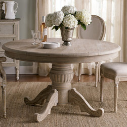 Valmont Dining Table - The perfect gathering place for friends and family, we can picture this rustic pine table in a charming Provençal cottage. The round top is supported by a handsomely carved pedestal base, while an intensive multi-step finishing process results in a distressed patina that lends it the timeworn character of age.