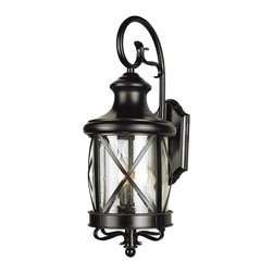 """Trans Globe Lighting - England Coast 19"""" Outdoor Wall Light In Bronze - Coastal New England horse and carriage hanging lantern. Cross bar frame with rounded seeded glass. Wrought iron wall arm and temple top cap."""