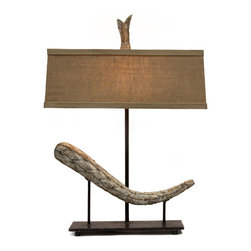 Laurel Fragment Lamp - A restrained rectangular lamp with a natural-hued linen shade meets contemporary found art to make the Laurel Fragment Lamp, an artisan task-lighting source that you will want to place in the center of a room. The iron base sprouts three slender columns, the center one supporting the shade and its naturalistic finial while the two on the outside form a gallery presentation for a curve of rustic patina wood. The shallowness of shape is delightfully unexpected and suggests two-dimensional art. The lamp is professionally finished with solid brass fittings and a cloth-wrapped cord; its maximum voltage is 150 watts.