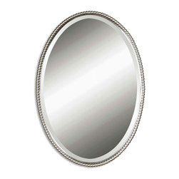 Sherise Oval Mirror - In the Sherise Oval Mirror, one may catch the reflection of a shimmering midday sun, a sliver of silver moon, a posy of blooms peeking out from a vase, or  the winsome smile of someone dear. The mirror boasts a glimmering metal frame of brushed nickel with a decorative beading design; a generous bevel suggests old-world glamour. The piece may be hung horizontally or vertically, allowing for ease in placement.