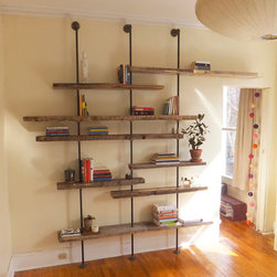 Adjustable Rustic Modern Shelving Unit of Reclaimed Wood - The Hover shelving unit is made from assorted hand-selected reclaimed wood, iron piping and polished copper clamps. Each shelf is adjustable to any height and size and designed specifically for the client's space. Shelves adjust to fit artwork and large books and house a book collection beautifully. Each unit is designed to fit the client's unique specifications. The outcome is a custom piece unlike any convention shelving unit.
