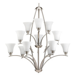 Progress Lighting - Progress Lighting P4497-09 Joy 1Two-Light Three-Tier Brushed Nickel Chandelier W - Gleeful simplicity defines this twelve-light, three-tier chandelier from the Joy Collection. Refreshing and fashionable arcing forms of Brushed Nickel metal arms enhance the etched white fluted glass. Coordinating fixtures from this collection let you decorate an entire home with confidence and style. Unique stem-hung construction carries the clean line all the way to the ceiling and, for sloped ceilings, ten feet of 9 gauge chain is provided to allow the fixture to hang straight and level.