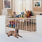 North States Extra Wide Stairway Swing Gate - You don't have to sell your house when baby arrives just because your stairs are too wide for most gates (admit it you've considered calling the realtor). The North States Extra Wide Stairway Swing Gate expands to over five feet wide to protect your little one from nasty tumbles. The gate securely attaches to the wall with 4-point steel mounting hardware safely addressing your housing concerns so you can stay put and keep decorating the nursery. Although this gate features a childproof lock adults will find it easy to operate with just one hand - a plus since your other will probably be carrying a baby. The gate swings in out or both ways with the swing control hinge. Made from sturdy wood with an elegant slatted design this gate won't be an eyesore like some white plastic versions. The gate removes from its hardware mount for storage when your child learns to use the stairs; simply reattach it when your next bundle of joy needs protecting. About North StatesWhether you're trying to protect your kids from your home or vice versa North States has the gate you need for any space. The company's plastic wood and metal gates are all easy to set up and certified by the Juvenile Products Manufacturers Association for safety. With products sold worldwide North States offers the most versatile and economical gates and enclosures in the industry. Your beloved little ones will be safe from the world... and the world from them... when you use North States gates.