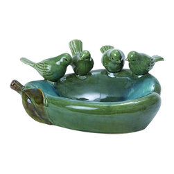 Benzara - Unique Design Pear Shaped Ceramic Bird Basin in Green Finish - Finding the right basin to fit your home can be quite a hassle sometimes. This Unique Design Pear Shaped Bird Basin, however, is all set to suit your desire for something different. It comes in the color green and is made from high quality ceramic. Its distinctive style makes it stand out from the rest. The green shade gives a lively appearance while the glossy finish adds to the beauty. It has four finely detailed birds which add an artistic and stylish touch to the basin. The entire basin sports a pear shape structure which enhances its uniqueness. The high quality ceramic makes it durable. This design is originated in China. It comes with a dimension of 5 in.  H x 12 in.  W x 10 in.  D.