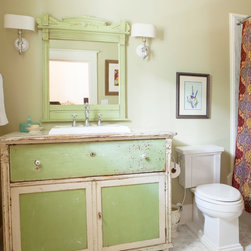 customer bathroom - Antique server in original green and white paint was made into a vanity for the guest bath by the customer.  The customer's vintage mirror was painted to match.