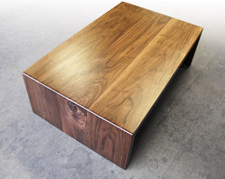 Walnut Waterfall Coffee Table - Brandner Design - Our Walnut Waterfall Coffee Table is simply that ... Black Walnut boards that flow to the floor.  Beautifully hand crafted and seamlessly joined with the grain of each board running continuous through the table. Available as a coffee table or a desk.  Please contact us at sales@brandnerdesign.com.