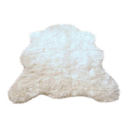 Hollywood Love Rugs - Super Plush Fake Polar Bear Rug 3' 5 x 4' 6 Medium - Brand new product manufactured in and imported fromFrance. Super plush, extra heavy and long pile Faux Polar Bear Rug in a beautiful soft white. Truly exotic with with authentic faux hide appearance.  These beautiful and affordable fake animal rugs are made with a rubberized non-skid backing. Washable, hypoallergenic, stain and soil resistant and naturally fire retardant without the use of chemical treatments. It's non-skid backing makes these rugs appropriate for every room in the home, including the bath or adventurous child's room. Vacuum only with hand held non-agitator vacuum. Wash with cold water and Woolite on gentle cycle and air dry.
