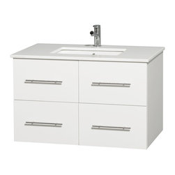 Wyndham Collection - Centra Bathroom Vanity in White,White Stone Counter,UM Sink,No Mirror - Simplicity and elegance combine in the perfect lines of the Centra vanity by the Wyndham Collection. If cutting-edge contemporary design is your style then the Centra vanity is for you - modern, chic and built to last a lifetime. Available with green glass, pure white man-made stone, ivory marble or white carrera marble counters, with stunning vessel or undermount sink(s) and matching mirror(s). Featuring soft close door hinges, drawer glides, and meticulously finished with brushed chrome hardware. The attention to detail on this beautiful vanity is second to none.