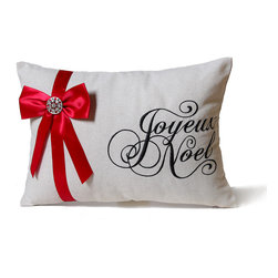 14 Karat Home - Script with Bow Pillow - Joyous Noel is the perfect holiday pillow.  The natural blended fabric is adorned with our beautiful scripted words and our beautiful Joyous for the holiday season.  Bejeweled embellishment on red ribbon shines with the jet black script on natural fabric.