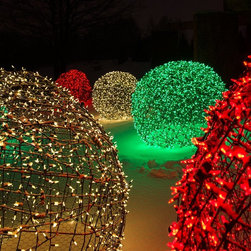 Ideas for Unique Outdoor Decorations - LED light balls made out of LED mini lights are perfect for illuminating outdoor spaces. Here are some of our lights wrapped around balls and displayed at the Chicago Botanical Gardens. Light balls can bedeck backyards or front yards during Christmas, the holidays season, weddings and other outdoor events.