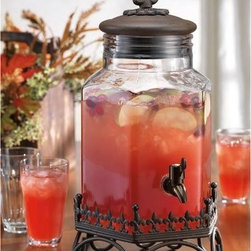 Fleur De Lis Hexagonal Glass Drink Dispenser with Metal Lid and Stand - A great crowd pleaser this elegant beverage dispenser holds 1.5 gallons.