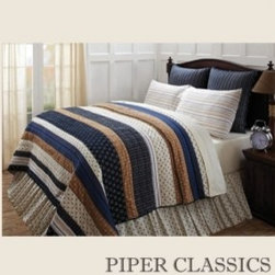 Seapoint Quilted Bedding - Set sail with crisp navy, cream and tan. Seapoint Quilted Bedding features printed stars, compasses and nautical ropes, balanced with woven stripes, 100% cotton shell and fill.