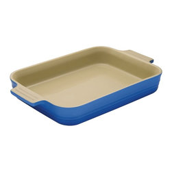 Le Creuset - Le Creuset Heritage Stoneware 7-by-5-inch Baking Dish - Le Creuset stoneware dishes are versatile, multipurpose designs that offer all the even-heating benefits of stoneware in a variety of shapes and capacities to fit nearly any baking, roasting or broiling recipe. Each dish features grooved handles for a sure grip, plus Le Creusets glazed interior that protects against utensil damage, staining and odor absorption  making each dependable piece of stoneware both easy to use and easy to count on.