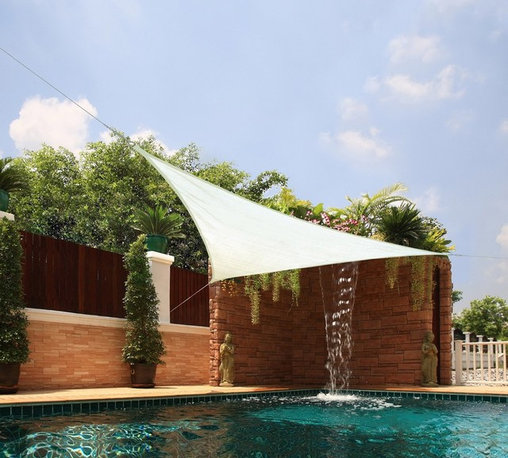 Medium Triangle Sail Sun Shade - The modern shape of this triangle canopy is not only slick to look at, it's versatile shape can tie on to any 3 points in your yard.