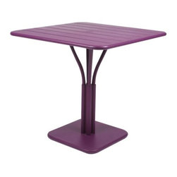 "Fermob - Luxembourg Square Table by Fermob - The Fermob Luxembourg Square Table pairs the smooth style of the Luxembourg collection with a distinctive pedestal base. The parasol hole in the center of the aluminum tabletop accommodates a standard patio umbrella or can instead be fitted with the included matching cap. Choose between all Fermob colors, and coordinate with Luxembourg Stacking Chairs or Armchairs. Based in Thoissey, France, Fermob has been creating fine outdoor furniture since 1953. Their current line of colorful and comfortable aluminum and steel furniture promotes the ""Outdoor Lounge"" way of life. It encourages outdoor rest and relaxation while caring for, protecting and improving the environment it inhabits. All Fermob outdoor furniture is made in France out of recyclable materials."