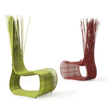 Eco Friendly Furniture and Lighting - 'My palette of materials consists of rattan, buri, kawayan and abaca. Each has their own texture, colour, smell and sound. You can bend, twist and weave them in endless ways. It is a feast of the senses to work with these,' Yoda hi-back lounge chair consists of natural or stained rattan vines woven on a frame of mild steel in a design that uses natural material tension. Colours: natural, red, green, wenge.