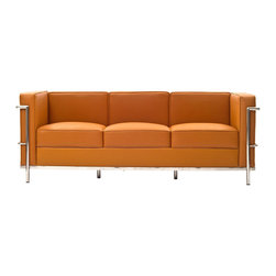 LexMod - Le Corbusier Style LC2 Sofa in Genuine Tan Leather - Urban life has always a quandary for designers. While the torrent of external stimuli surrounds, the designer is vested with the task of introducing calm to the scene. From out of the surging wave of progress, the most talented can fashion a forcefield of tranquility.