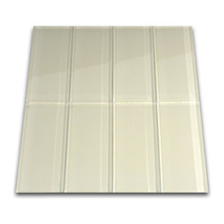 "CNK Tile - Cream Glass Subway Tile - The creme subway tile is made from the strongest stain-resistant crystal clear glass. These tiles have a 8mm thickness that increases their durability and the depth of their color making them truly beautiful subway tiles. These subway tiles can be used for commercial or residential construction in either a wet or dry environment. These subway tiles are sold by the square foot comprised of 8 individual tiles. The individual tiles measure 3""x6"". This product comes on a mesh backing for easy installation."