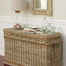 St. Lucia Console - This oversized rattan trunk is a perfect combination of stunning beauty and functionality. The rattan construction is trimmed with thickly braided jute rope on top and bottom and accented with jute rope side handles. The top is removable to allow for ample storage space.
