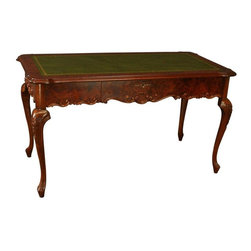 Used Rococo Style Burled Mahogany Veneer Green Desk - A versatile, handsome Rococo style desk from Italy! Crafted of solid wood with burled mahogany veneers, this high-quality reproduction piece weighs 100 pounds! The spacious green leather writing surface makes a great place to spread out papers, homework, or craft components. A single drawer offers a place to keep pens, scissors, or whatever you desire. Measuring nearly 5 feet wide by nearly 30 inches deep, this fabulous desk will function well for its intended purpose or as a sensational crafting table! Functionality plus utility make this great Italian Rococo style desk a great value.    Overall Condition is Used - Good. Shows minor wear to the finish and scuffs to the leather writing surface due to age and use as showroom sample.