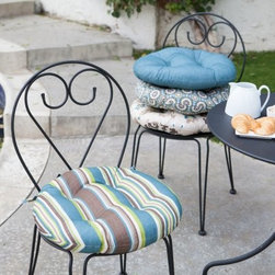 Ulani Bistro Outdoor Round Seat Cushion - 16 in. - Those bistro chairs are as cute as they are uncomfortable. Soften them up in style with the Ulani Outdoor Round Seat Cushion - 16 in. This round cushion is tufted for added panache and comes in a variety of popular color and pattern options you'll love. The polyester fabric is designed to stand up to life outdoors and is treated to resist fading, mold, and mildew. This cushion has 3 inches of plush cushioning and a round shape that's perfect for those bistro chairs. Ahh...that's better.