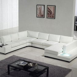 Modern white top grain leather sofa - This ultra modern sectional sofa made from top grain leather in combination with best leather match is a fashionable and functional piece of contemporary living room furniture. This modern sectional can seat 7 people luxuriously, and features two end tables, and one with a built in light! This is a beautiful piece of furniture that any contemporary furniture connoisseur would love to have in their home.