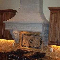 Le Petite Cast Stone Range Hood - The LE PETITE kitchen range hood is particularly suited for situations with limited space. It can be done with or without the carvings.