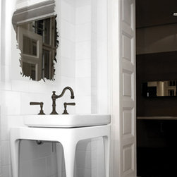 Featured Vendor - Watermark Designs - A modern twist on a classic white pedestal from Watermark Designs is a unique focal point for this small bath.