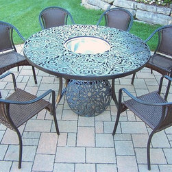 Oakland Living - 8-Pc Round Dining Set - Includes one table, six resin wicker stackable dining chairs, stainless steel ice bucket and metal hardware. Handcast. Traditional lattice pattern and scroll work. Fade, chip and crack resistant. Umbrella hole table top. Hardened powder coat. Warranty: One year limited. Made from rust free cast aluminum, steel and resin wicker. Black color. Minimal assembly required. Chair: 23.25 in. W x 25.5 in. D x 34 in. H (14 lbs.). Table: 60 in. Dia. x 29 in. H (70 lbs.). Overall weight: 180 lbs.This dining set is the prefect piece for any outdoor dinner setting. Just the right size for any backyard or patio. The Oakland Tuscany Collection combines southern style and modern designs giving you a rich addition to any outdoor setting.